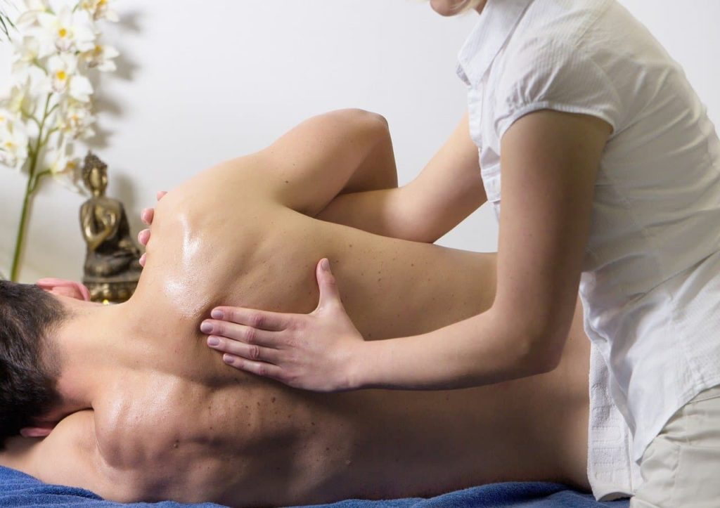 Man In Back Pain Physiotherapy